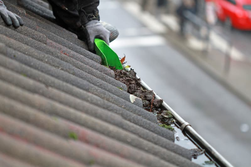 clearing debris from gutter