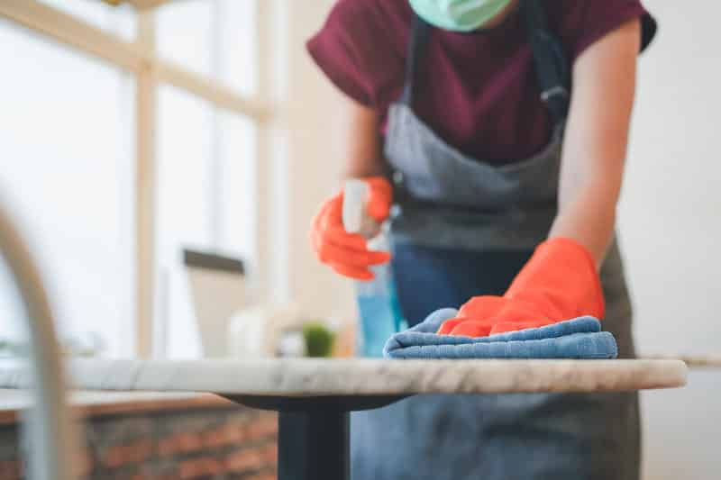 Commercial cleaner cleaning tables