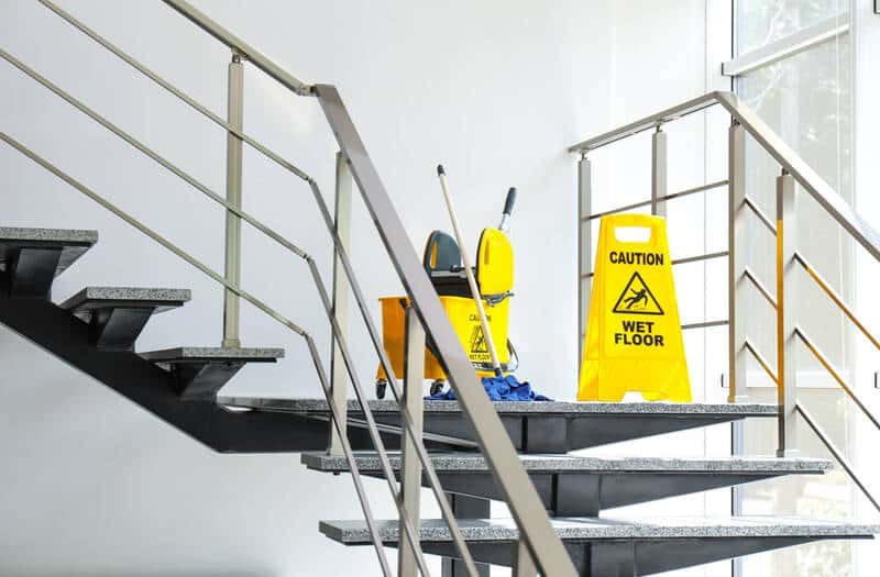 safety sign and cleaning bucket